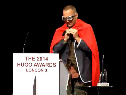 "Cory Doctorow accepting the Best Graphic Story Hugo Award for Randall Munroe's ""Time."". Photo by Jim C. Hines"